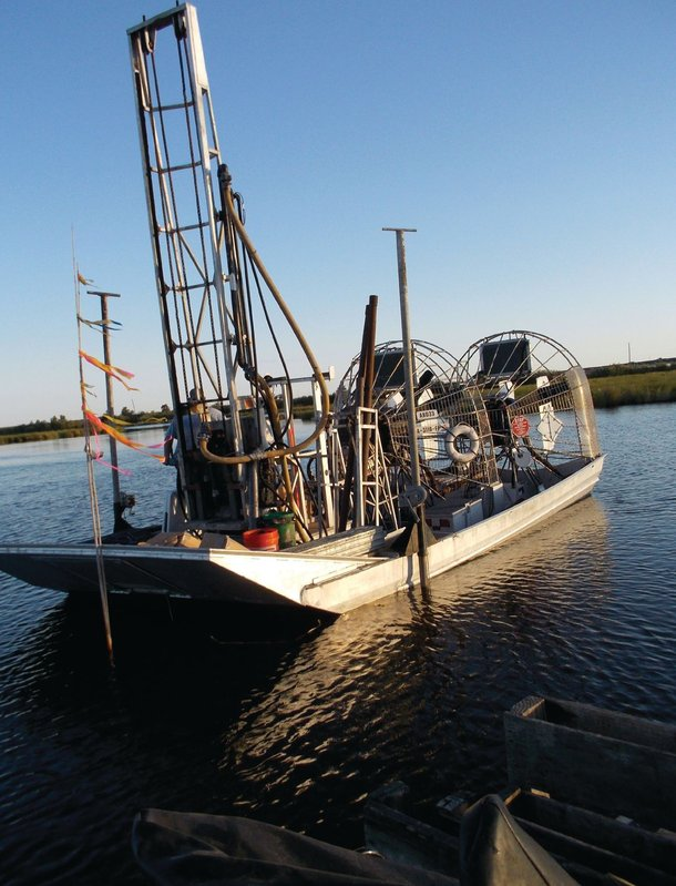 Specially adapted drill rigs, such as this one mounted on a three-engine airboat, are used to collect soil samples from proposed marsh creation project areas in the field exploration/data collection phase of marsh creation geotechnical investigations.