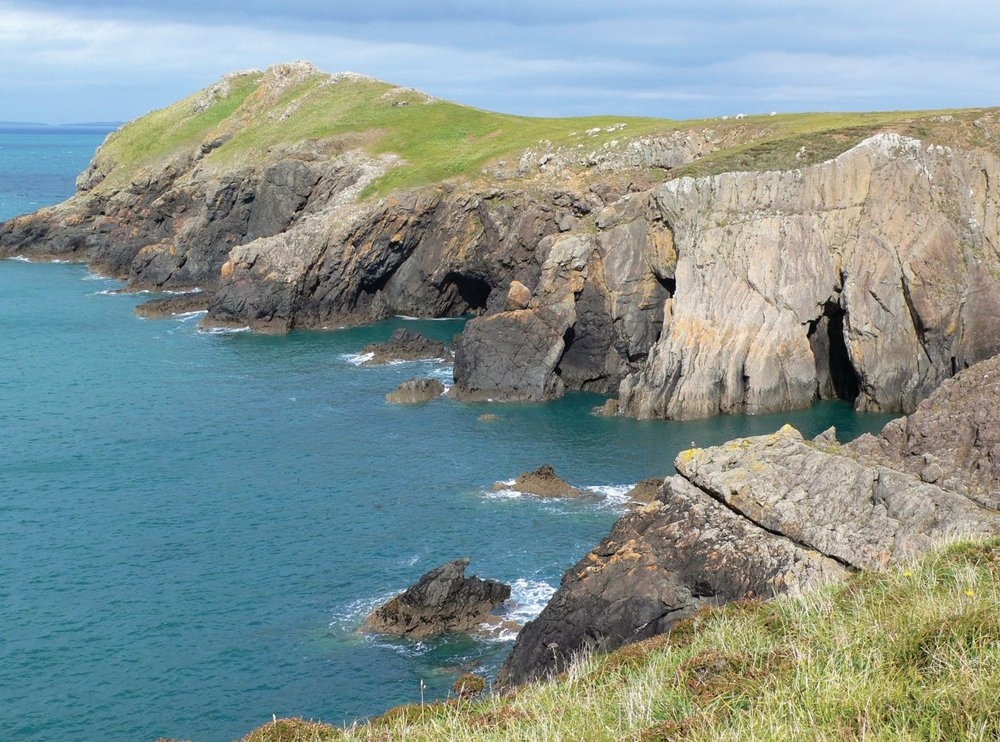 Pembrokeshire coast near Martin's Haven. Note the caves carved into the rocks. Photo courtesy of Malcom Smith.