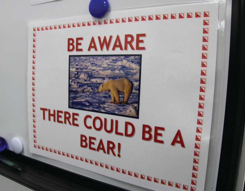 This safety sign on Northstar Island is one of the ways employees and visitors are reminded to stay vigilant about polar bears. Photo credit: Guy Hayes, Alaska Region Public Affairs Specialist, BSEE.