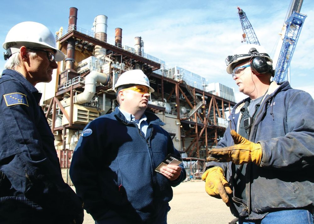Michael Jordan (center) and Randy Howell (left) speak with Hilcorp Alaska, LLC foreman Lance Kulhavy during an inspection at Northstar Island. Photo credit: Guy Hayes, Alaska Region Public Affairs Specialist, BSEE.