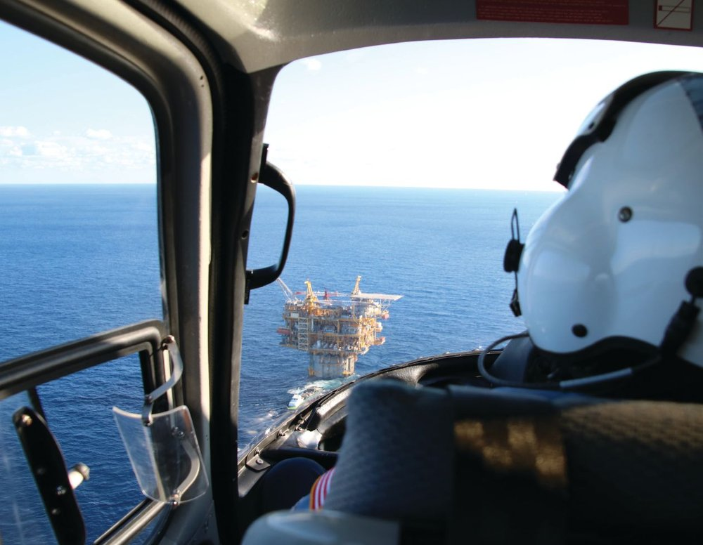 Peering over the shoulder of BSEE Inspector Sammy Viola, Front Runner platform can be seen on the horizon during final approach Oct. 25 as part of an inspection to oversee operations. Front Runner, a truss spar facility operated by Murphy Oil, is located 85 miles offshore in the Gulf of Mexico and is capable of producing 60,000 barrels of oil and 110 million cubic feet of gas per day.