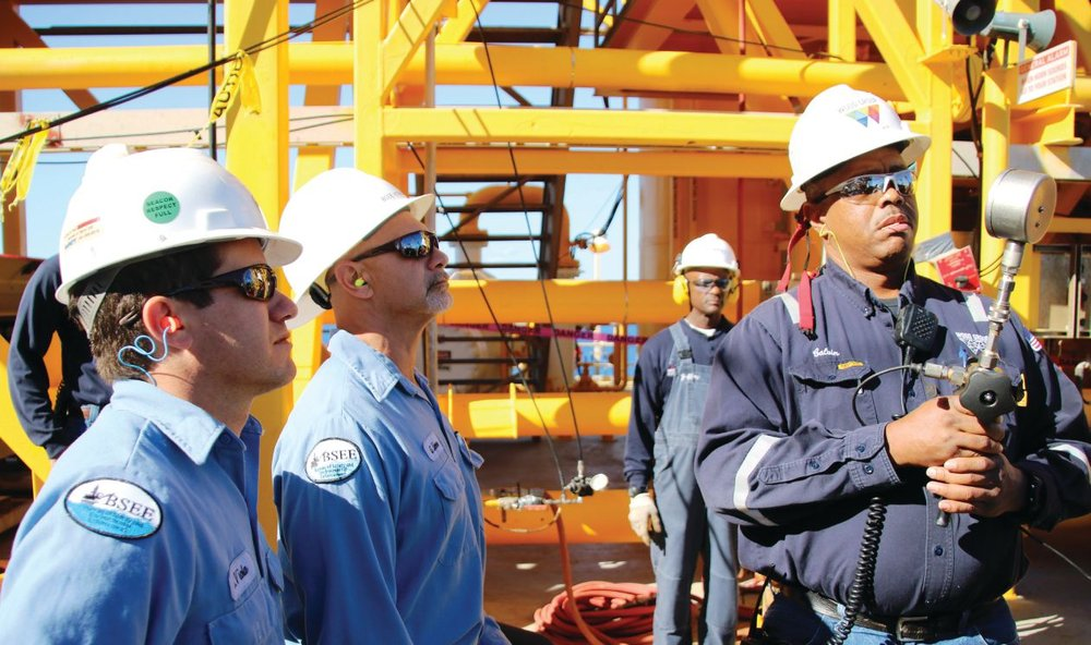 BSEE Inspectors Sammy Viola (left) and Greg Liner closely monitor a pressure gauge held by Murphy Oil employee Calvin Solomon during a pressure test of temporary equipment on Front Runner, a deep-water facility in the Gulf of Mexico.