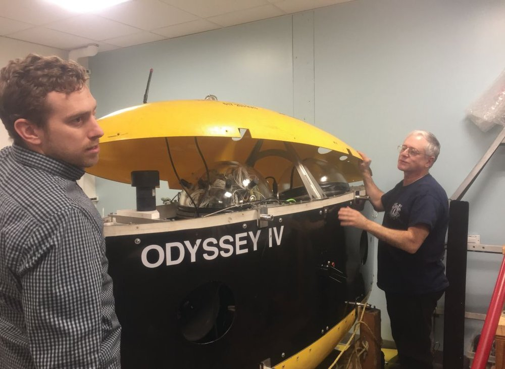 Michael Defilippo and Michael Sacarny of MIT Sea Grant displaying their research submarine Odyssey IV at their new Cambridge, Massachusetts office.