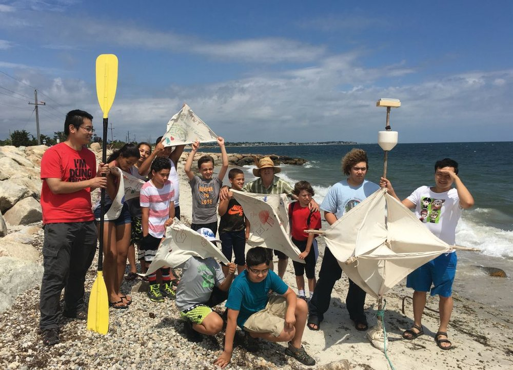 NOAA WHOI Manning Lab and local students about to launch their drifters off Cape Cod, Massachusetts in late summer 2016. Bingwei, inventor of the diamond-shaped drifter, shown holding a completed bamboo diamond-shaped drifter to the far right. 4 of 8