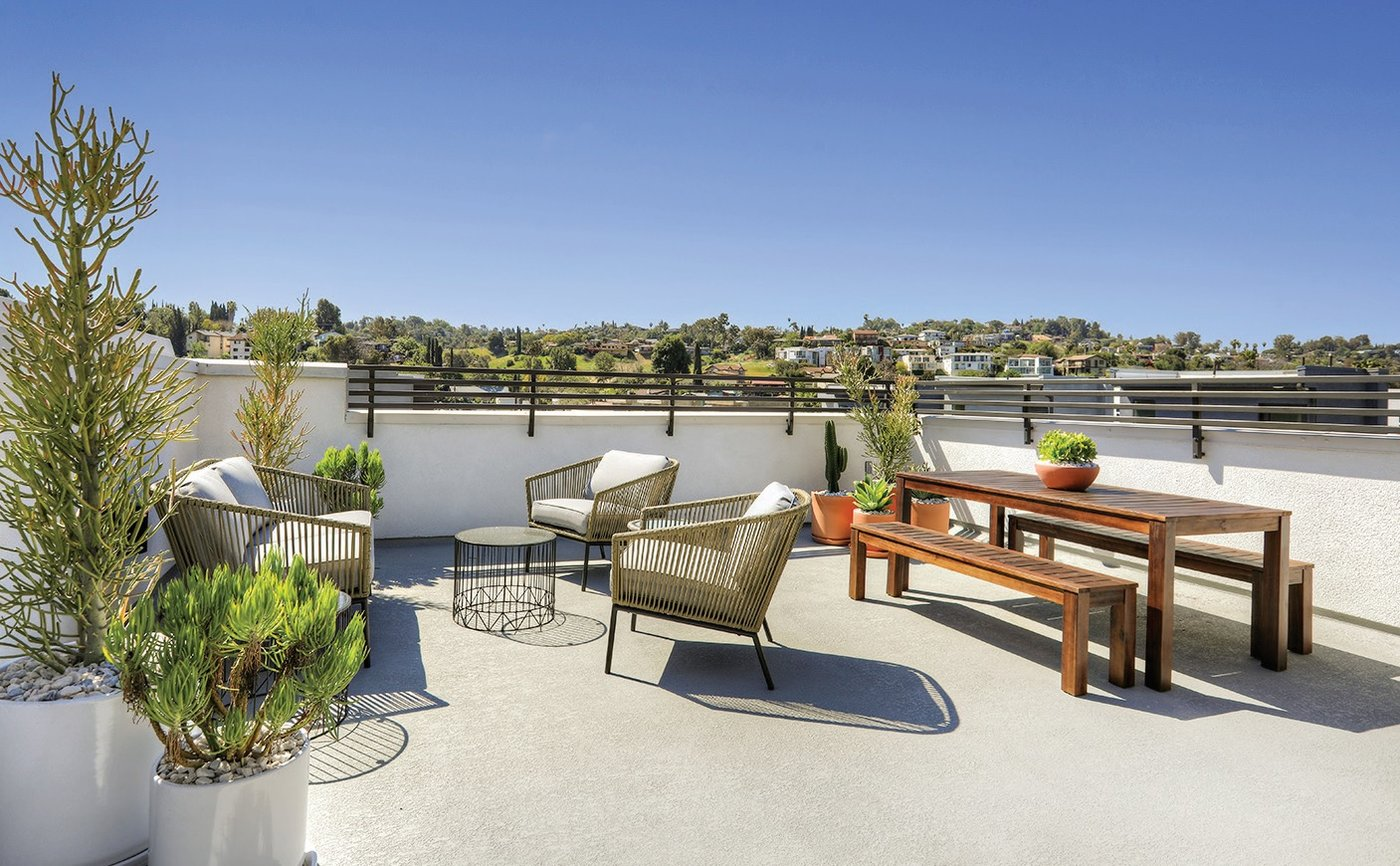 Urban Garden Private rooftop decks bump the home's prime entertaining space to the outdoors.