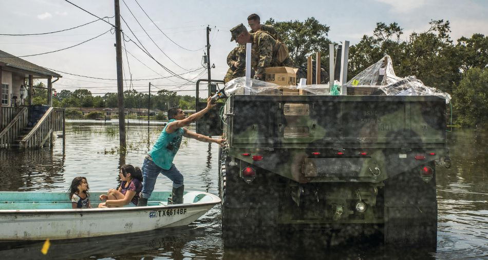 Marines hand supplies to a family in Orange, Texas, Sept. 3, 2017, during recovery and relief efforts following Hurricane Harvey. Marine Corps photo by Lance Cpl. Niles Lee
