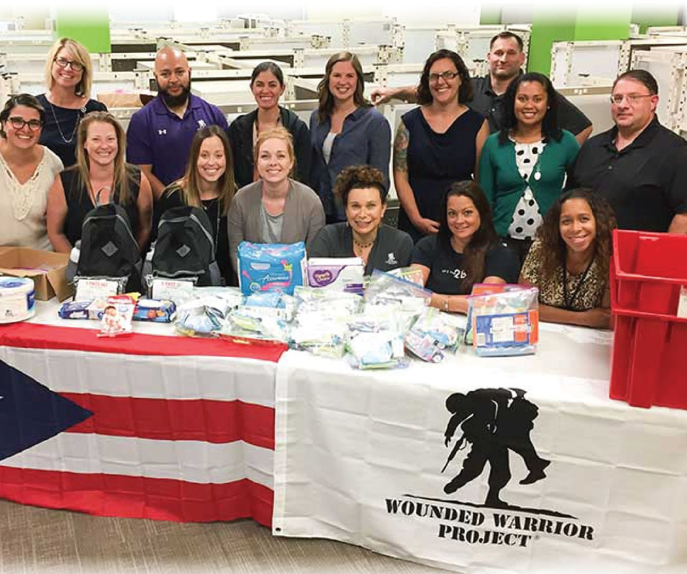 Employees take part in a volunteer service project to create packages for those affected by Hurricane Maria in Puerto Rico.