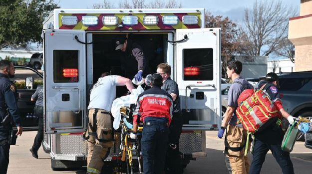 Emergency personnel from the Fort Worth Fire Department work on a wounded member of the West Freeway Church of Christ who was wounded when a gunman opened fire during a Sunday, Dec. 29, 2019 service.