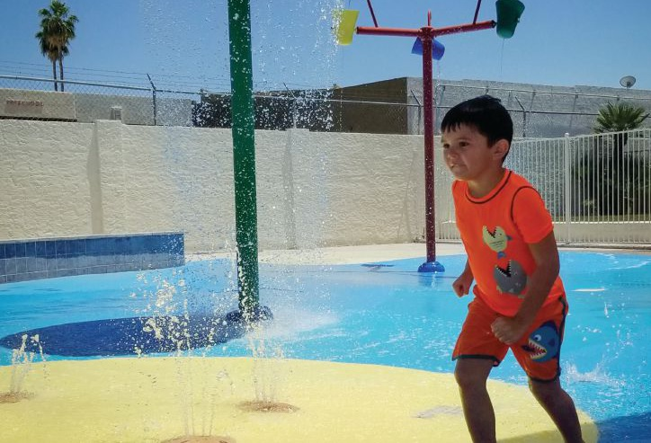 COOL RUNNINGS. A young resident walks on the splash pad at Dobson Ranch Homeowners Association in Mesa, Ariz. The popular attraction is open with limited hours this summer to reduce the number of people in the area at one time. COURTESY DOBSON RANCH HOMEOWNERS ASSOCIATION