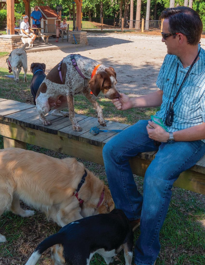 WAG THIS WAY. Homeowners at Hampton Lake Community Association in Bluffton, S.C., enjoy an outing at the association's Dog Paddle Park. Several residents have become new dog owners since the pandemic began. COURTESY HAMPTON LAKE COMMUNITY ASSOCIATION