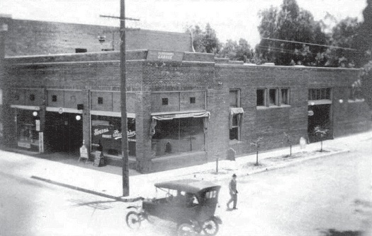 Historic photo of the 118 W. Chapman corner building, which was constructed and opened in 1915 as an auto repair shop. Photo credit: Orange, Images of America by Phil Brigandi