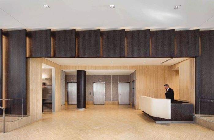 The lobby offers custom wood wall panels Photo by Pavel Bendov