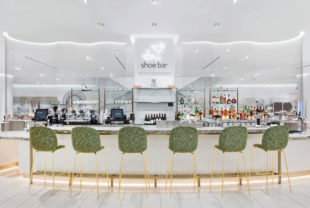 Shoe Bar debuts as a cocktail destination on the shoe floor. Customers can toast a celebratory moment or new purchase with a martini or glass of wine. There's also an all-day menu for shoppers to stop and refuel.