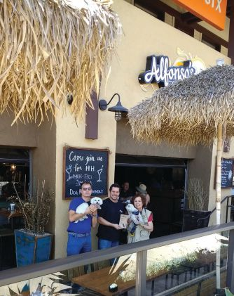 A warm welcome for pet patrons at Alfonso's of La Jolla in Solana Beach. Owner Jorge, center, with Tony and Vito, left, and Pam with Sonny, right. ALLEN LECHTMAN
