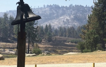 Our Adoption Bell (it rings for every adoption) still stands, looking over a charred Johnson Meadow.