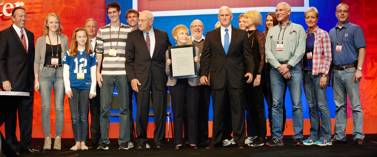 Don Wolf, shown here with wife Ginny, received the Sachem Award—Indiana's highest individual honor—from Indiana Governor Mike Pence in 2013.