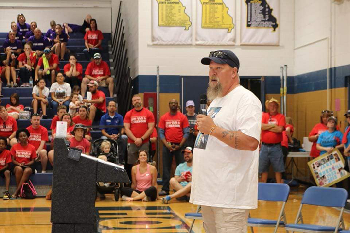 Adam Hendrix sharing about the loss of his son Justin to a heroin overdose at Wentzville's Walk to Stop Heroin event.