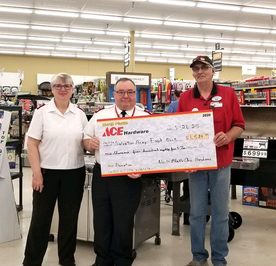 Douglas Wallace of North Platte Ace Hardware presents a check to the local Salvation Army.