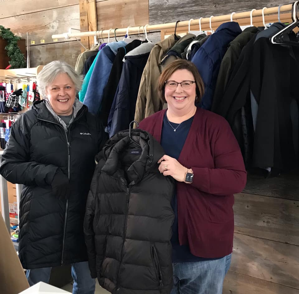 Barb Boley (left), president of the Keosauqua Chamber of Commerce, shows her support for the community coat drive started by Susan Wasko (right) of Wasko Hardware.