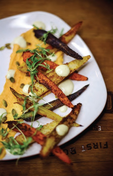 spiced carrots with roasted sweet potato hummus and smoked jalapeno aioli are a customer favorite.