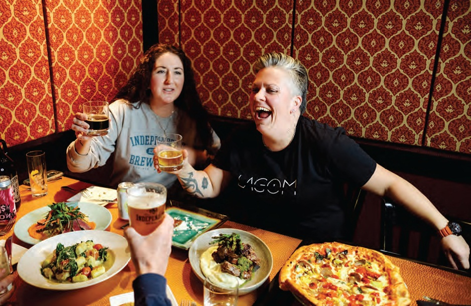 Beth Rhudy (left), co-owner of Independent Brewing and Lagom head chef and co-owner Kristina Sharp share a laugh over the restaurant's food and Independent beer.