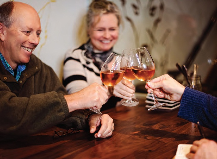 Polly Pittman and Tom Croghan toast with glasses of 2017 rosé from their winery,the Vineyards at Dodon before digging into a Thai Salad