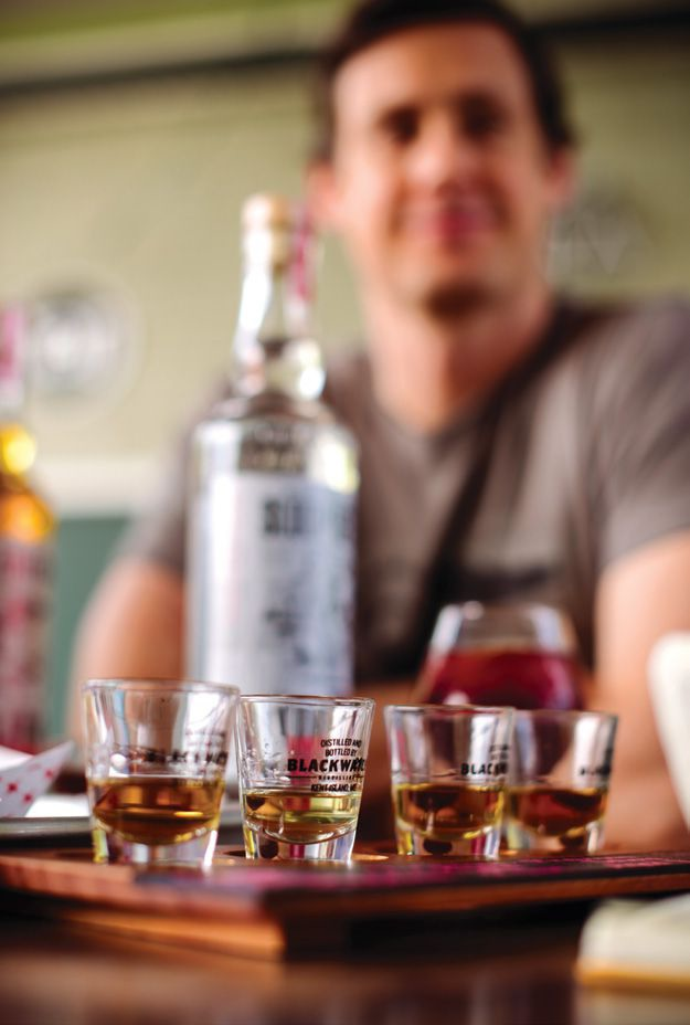 Head distiller Andy Keller proffers a sampling of Blackwater Distilling rums.