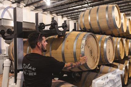 Mike Lentini, the winemaker, preps the barrels for fermentation.