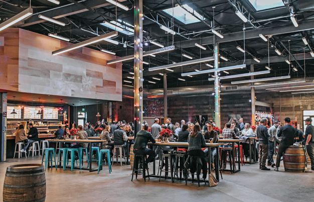 The cavernous Union Craft Brewing tasting area, adjacent to Well Crafted Pizza, is just one of the collective's offerings.