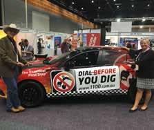 JimBob Sims ([f] Texas 811) and Khrysanne Kerr (CGA) pose with Dial Before car