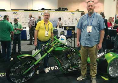 Tony Millikin and Ryan White (Shaw, Canada) posing with their mascot Bot and the 811 Bike.