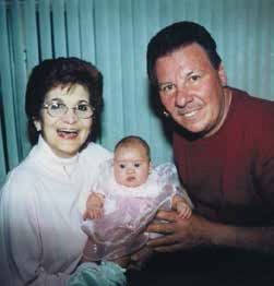 Barbara and her husband Robert, holding their first grandchild, Gabriella.