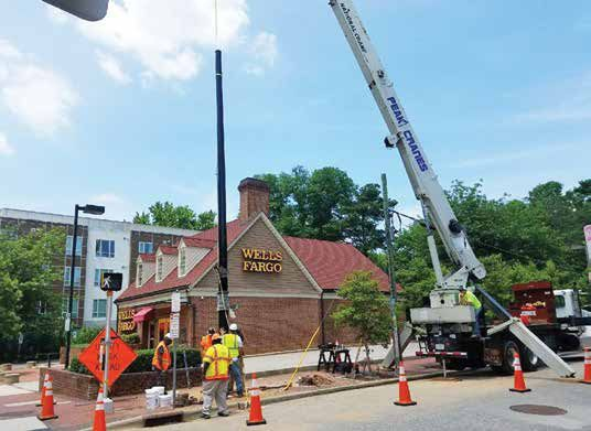 The Small Cell Services team completing a tower installation using a crane.