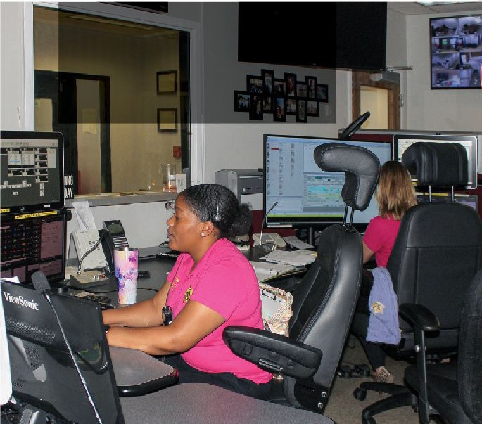 Devon Clary (r) leads a rotating team of 11 full-time emergency telecommunicators, including Trinity Harrison (l), at the Brunswick County Sheriff's Office.