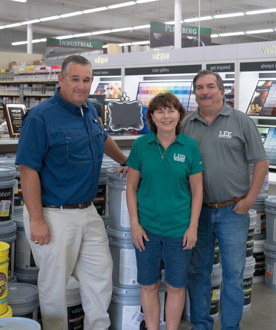 Jamie Bruner, Denise Lee and Richard Lee stand in the paint department, which saw sales triple after expanding to 2,000 square feet.