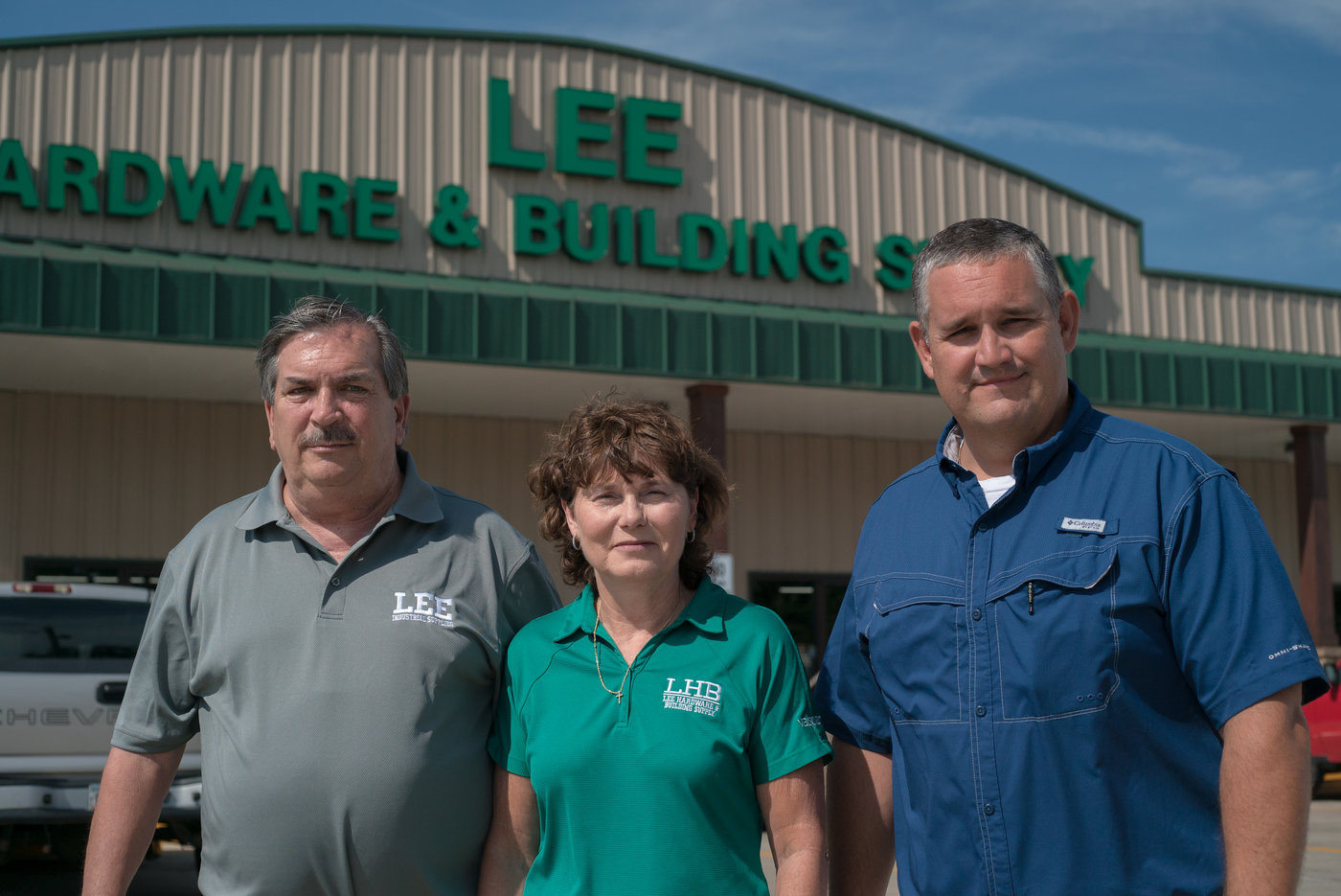 Richard Lee, Denise Lee and Jamie Bruner are proud of the new, larger Lee Hardware & Building Supply in Waycross, Ga.