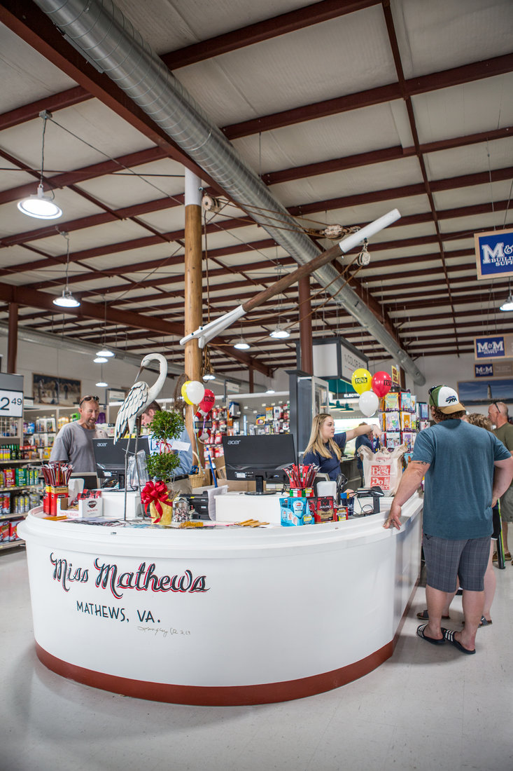 M&M Building Supply's new checkout counter was built to look like the stern of a deadrise workboat, the type of boat that used to be prevalent in their seafaring community of Mathews, Va.
