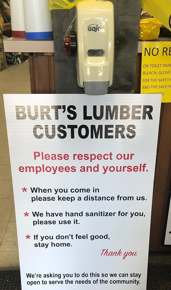 Burt's Lumber & Building Supply in Perry, N.Y., reminds customers to practice social distancing.