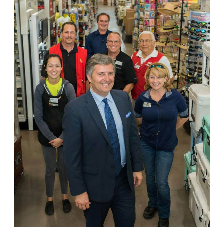 Michael Wynn, president of Sunshine Ace Hardware, is in front. Behind him l to r: Kaitlyn Pena, Mike Karp, Dan Granville, Scott Puch, Ray Chapa and Wendy King.