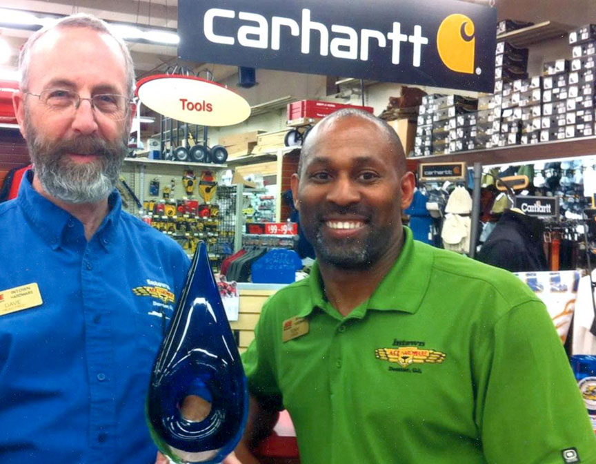 "Co-owners Dave Jones and Tony Powers pose with their trophy for being named one of Ace's ""Coolest Hardware Stores on the Planet"" in 2012."