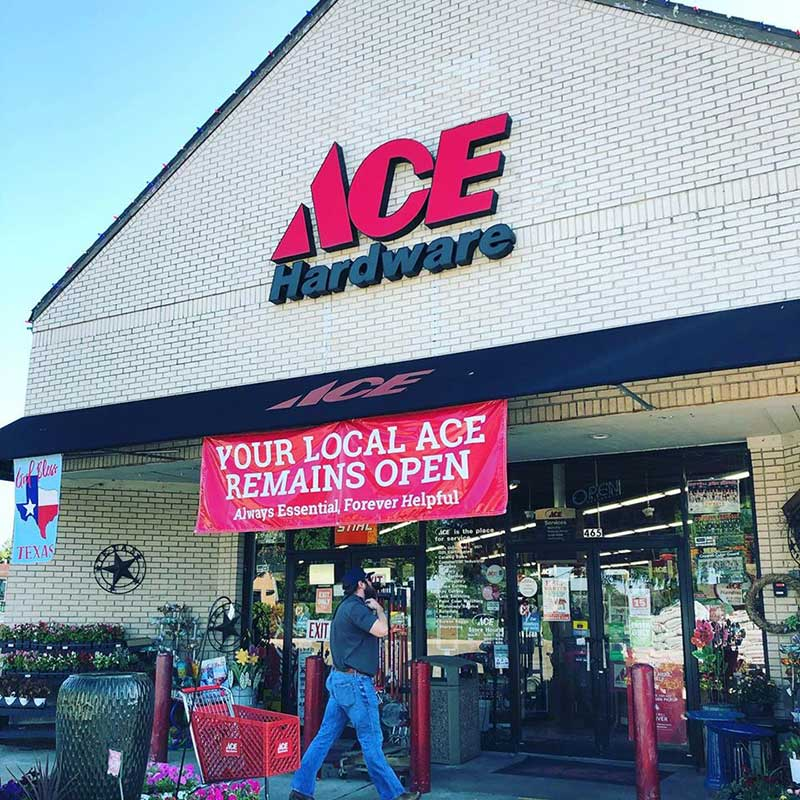 Prominent signage reminds customers that Jabo's Ace stores are open and essential.