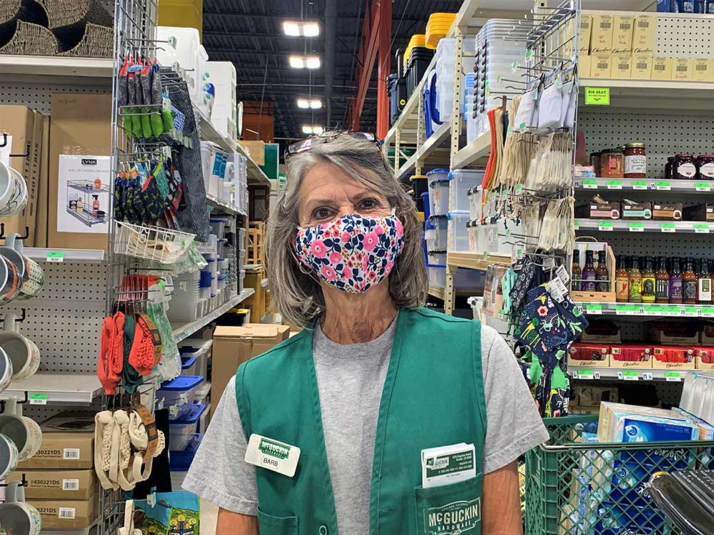 Customers felt safe shopping at McGuckin Hardware, because they are greeted by employees like Barb Beck who are wearing masks.