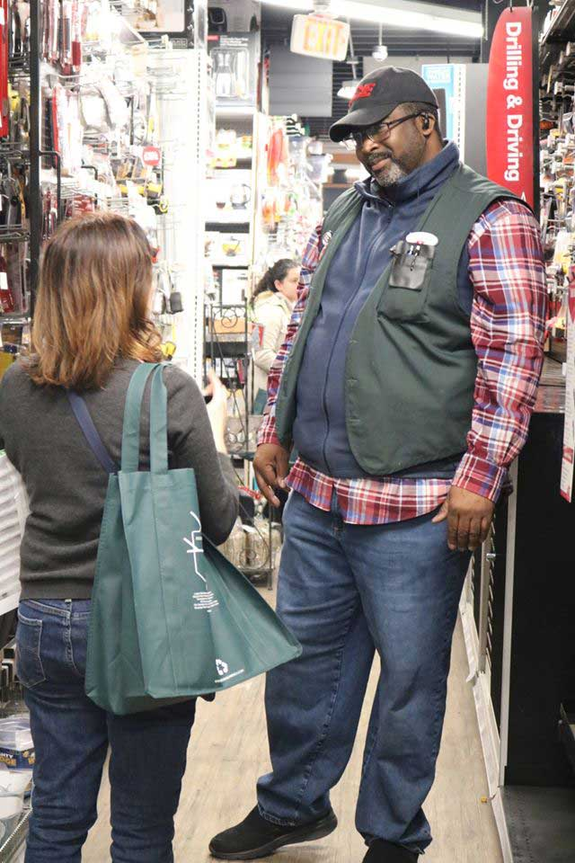 Manager Tim Hamm takes care of a customer at Logan Hardware in Washington, D.C.