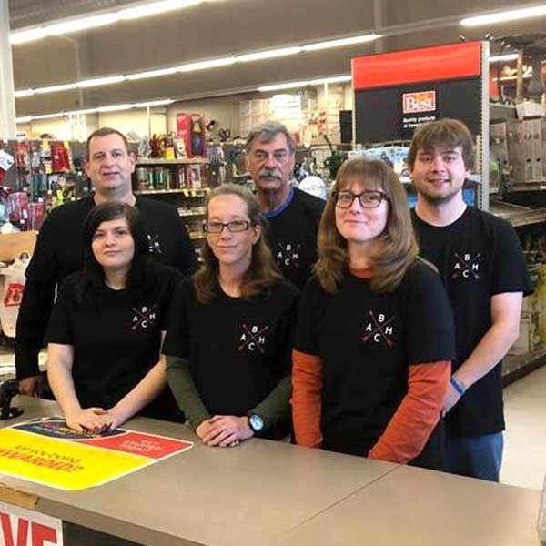 Kent Schaper (back left) and his team have restored the community's trust in the store.