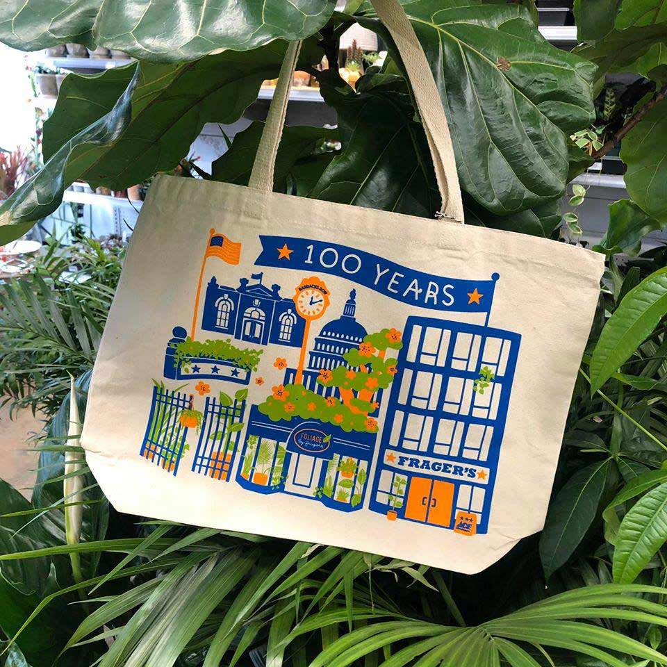 A Frager's 100th anniversary canvas tote, designed by a local artist, was available for purchase.