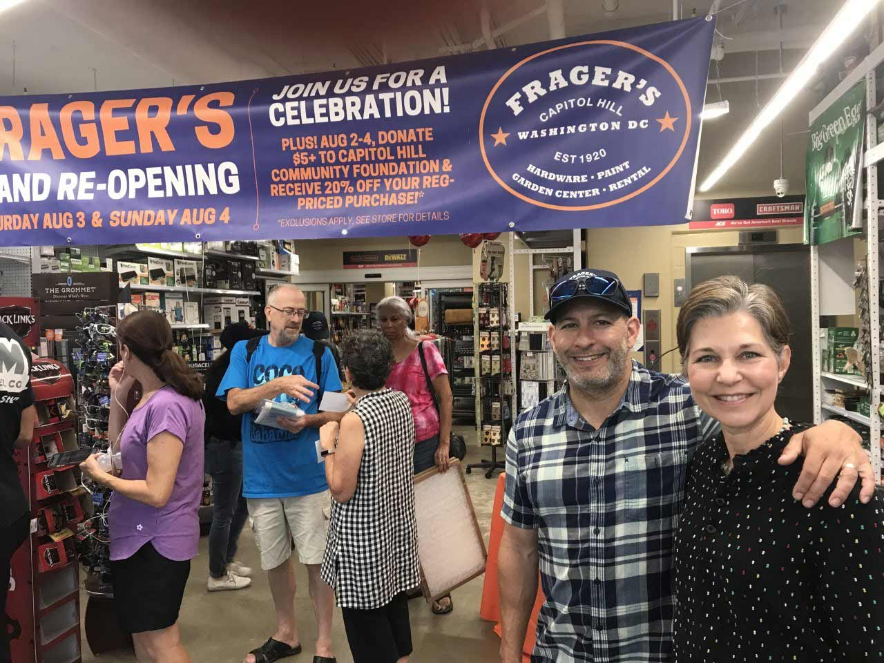 Marc Friedman and Gina Schaefer at the grand reopening at the store's original location in August 2019, two years after they bought Frager's Hardware from John Weintraub.