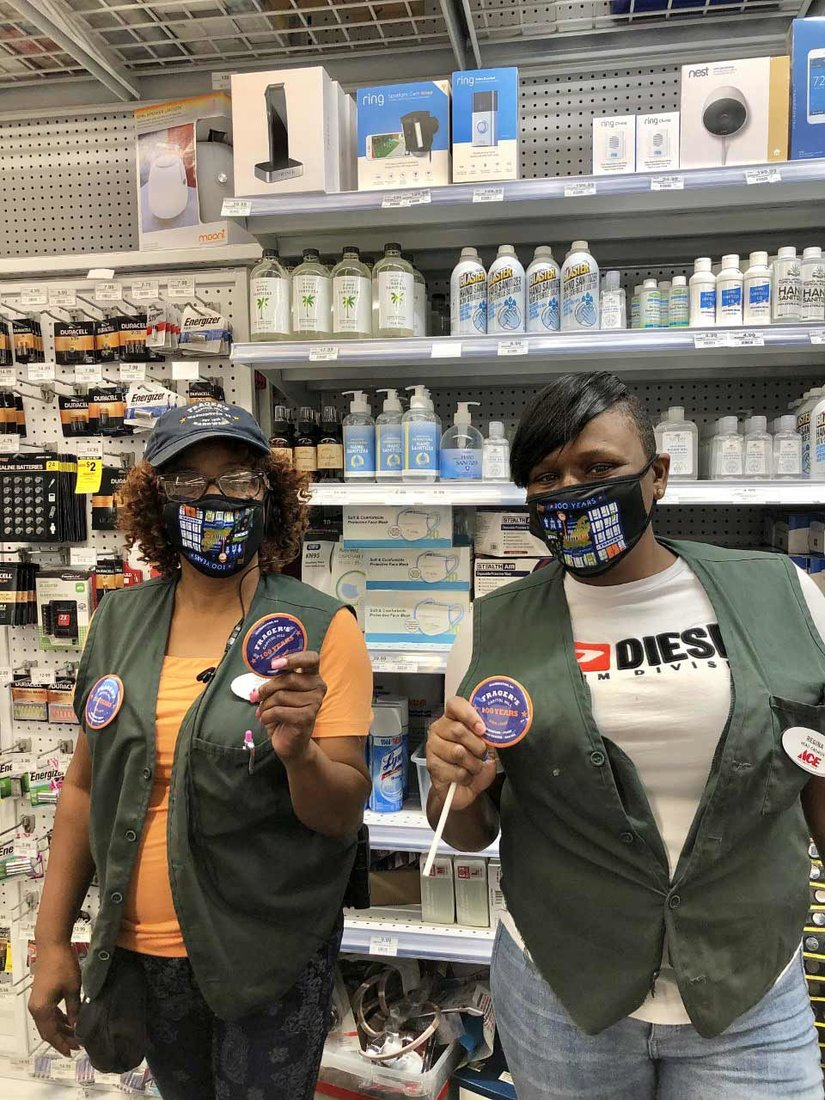 Zinia Brown (left) and Regina Whitaker hold the 100th anniversary Frager's buttons worn by staff throughout the celebration month, along with the 100-year masks.