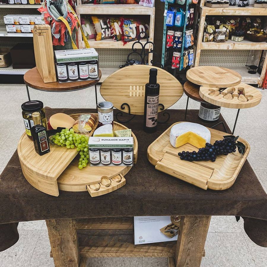 Cutting boards are merchandised with related food and accessories.