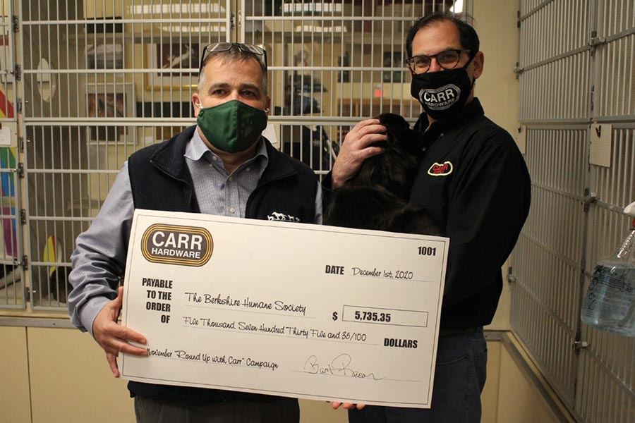 Bart Raser of Carr Hardware (right) presents a check to the Berkshire Humane Society.
