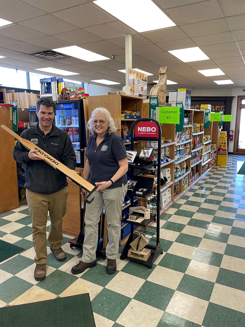 Michael Siewers and Jamie Naab, whoruns the hardware section at Siewers Lumber & Millwork, are checking out a deck wrecker tool.